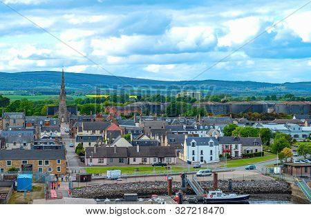 Dornoch, Scotland - May 28, 2019: The Country And The Harbor Platform Seen From The Sea