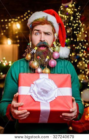 Confused Santa Claus Hold Present. New Year Clothes. New Year Eve. Santa In Home. Santa Claus. Merry