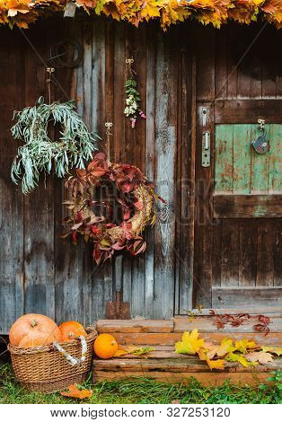 Fall Front Porch. Autumn Wreath And Pumpkins On Old Wooden Rustic Background At Doors. Autumn Compos
