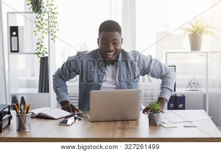 Pay Raise. Joyful African American Worker Looking At Laptop Screen With Excitement, Happy After Rece