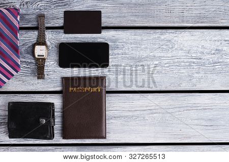 Watch, Wallet And Passport. Personal Mens Stuff In Restrained Tones. Cellphone And Visit Card.