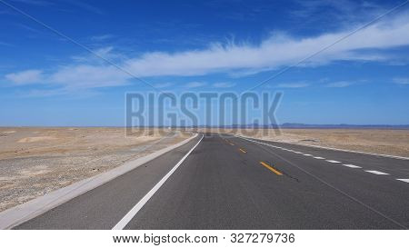 Nature Landscape View Of High Way Road Under Sunny Blue Sky In Dunhuang Gansu China.