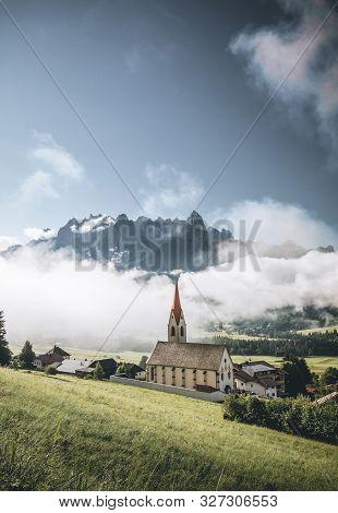 View Of Dobbiaco Lake And Surrounding Mountains. Dolomites, Italy