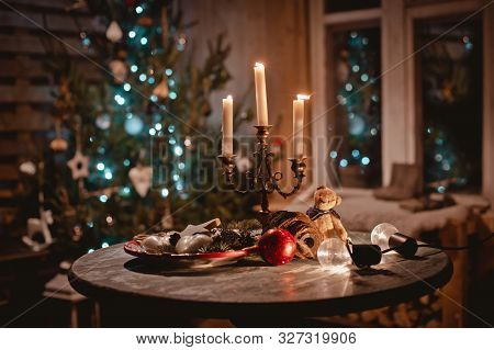 New Year Night Table Decoration With Candles And Antique Decorations On The Background Of Lights And