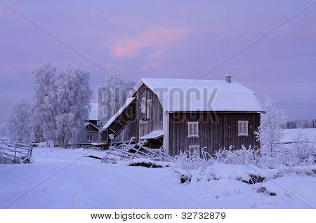 Building close to Kukkolaforsen in December lit, noon.