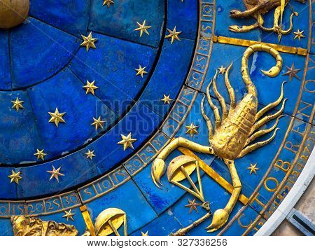 Scorpio Astrological Sign On Ancient Clock. Detail Of Zodiac Wheel With Scorpion. Golden Horoscope I