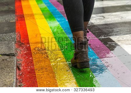 Legs Walking On Gay Rainbow Crosswalk. Female Legs Walking On Rainbow Crosswalk In Gay Parade. Gay P