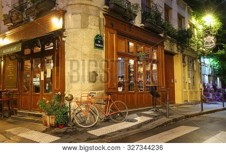 Paris, France-october 08, 2019: The Traditional French Cafe Au Bougnat At Night . It Located Near No