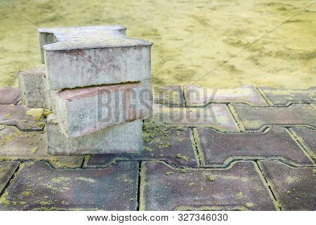 Several Pieces Of Paving Slabs Lie In The Place Of Repair Of The Sidewalk, Road, Square, On The Back