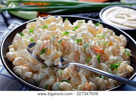 Close-up Of American Macaroni Salad With Shredded Carrots, Celery, Spring Onions And Mayonnaise Dres