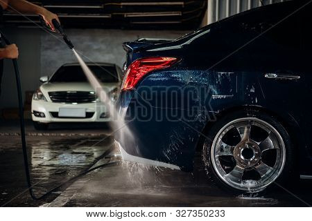 Car Care Staff Cleaning (clean, Wash, Polish And Wax) The Car (car Detailing) At Car Care Shop In Ba