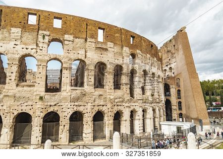 Rome, Italy - October 3, 2019: Crowd Of Tourists In Front Of The Ancient Colosseum Or Coliseum, Also