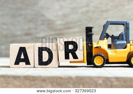 Toy Forklift Hold Letter Block R To Complete Word Adr (abbreviation Of Adverse Drug Reaction) On Woo