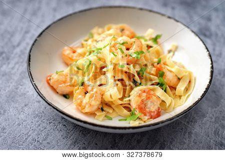 Close Up Of Shrimp Fettuccine Alfredo On Blue Background