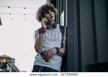 Young Man Talking On Phone Outdoors Stock Photo