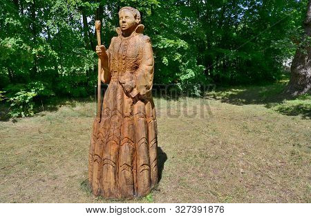 A Wooden Sculpture Of Woman In Nature, Czech Republic