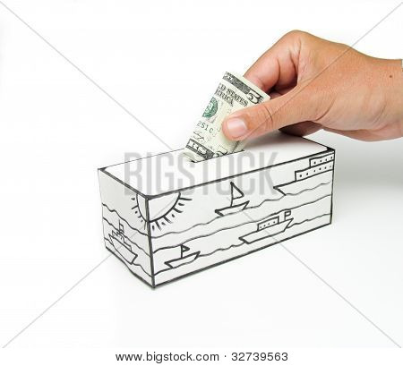Safe with sea and five dollars being deposited