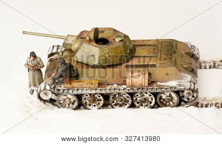 Legendary Soviet Tank T-34 At War In The Second World War. Winter View Diorama With Two Officers