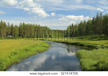 Beautiful View On Stream Petikan In The Rortrask Silanger Culture Reserve In Lapland.