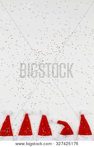 Santa Claus Hats On White Background With Little Stars. Christmas And New Year Celebration. Christma