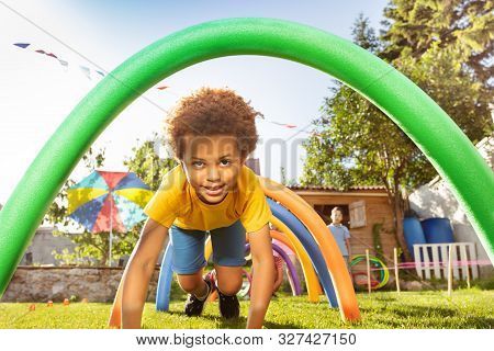 Boy Passes Under Barrier In Fun Competitive Game