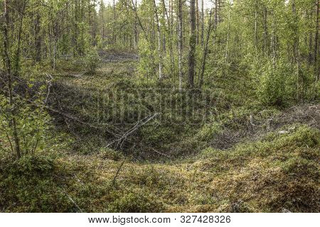 Remains Of An Ancient Trapping Pit Near At The Stream Skelleftalven In Vasterbotten, Sweden