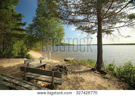 Sand Beach At Lake Vargforsdammen, A Reservoir In The Stream Skelleftealven In Northern Sweden