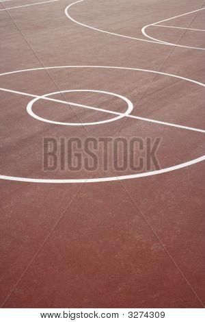 A basket ball hoop on an out door court poster
