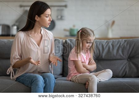 Stubborn Upset Little Daughter Ignoring Strict Mother, Family Conflict