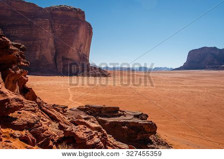 High Rocky Cliffs In Jordanian Desert Of Wadi Rum Area
