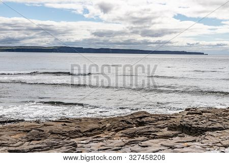 Rocks And Beach With Cliffs Of Moher In Background In Inisheer Island