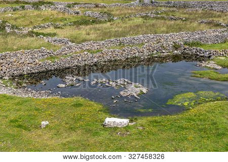 Farm Fields With Rock Walls And Lake In Inisheer Island