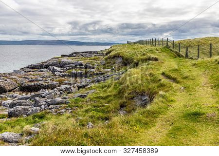 Trail With Rocks And Field In Inisheer Island With Burren In Background