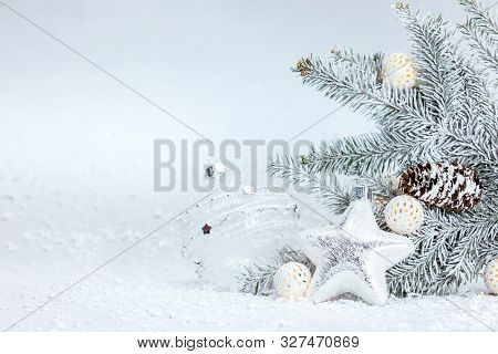 Snowy Cool Winter Background With Christmas Tree Branch, Decorative Glass Star And Balls