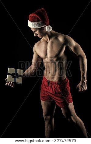 Handsome Santa Concept. Macho Muscular Torso Posing With Gift Box. Santa Claus For Adult Girls. Sexy
