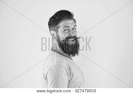 His Bearded Hair Looks Styled. Bearded Man Smiling On Yellow Background. Happy Bearded Hipster With