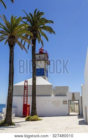 The Santa Marta Lighthouse Built In 1867 Is A Quadrangular Masonry Tower Covered With White And Blue
