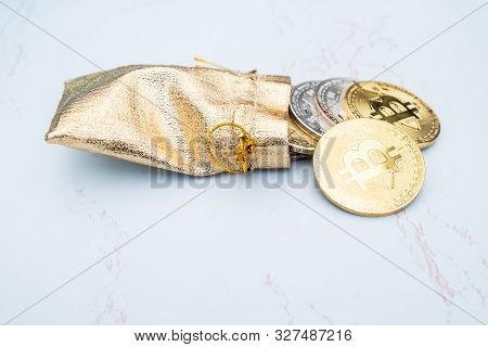 Bunch Of Crypto Currency Coins In A Golden Moneybag Or Wallet With Various Of Shiny Silver And Golde