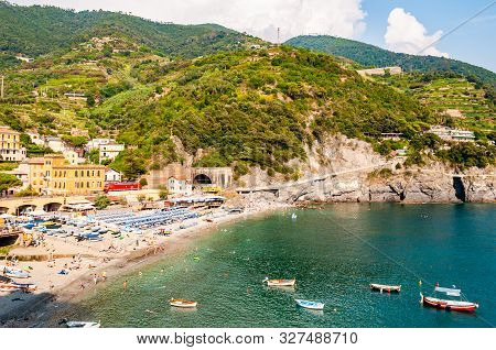 The Famous Landscape Of Monterosso Al Mare. Green Mountains Surrounding The City, Red Train Passing