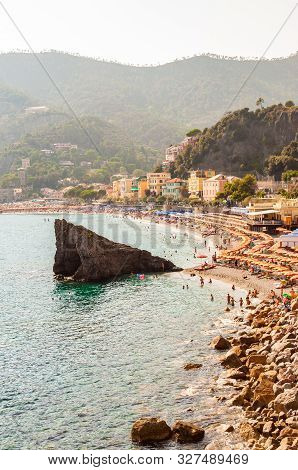 The Famous Beach Full Of Deckchairs, Sun Umbrellas Parasols, Sunbathing And Swimming Tourists In Mon