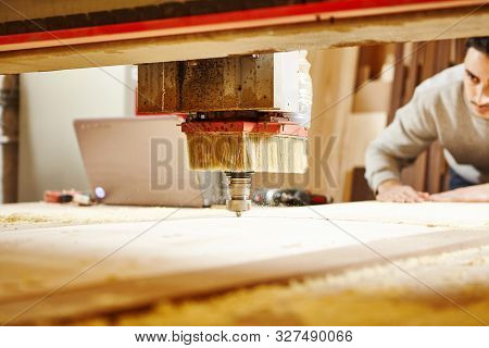 Cutting Wood Using A Machine With Numerical Control. Cnc Tool.