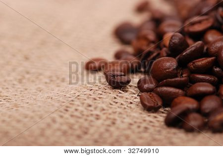 dark coffee beans over canvas
