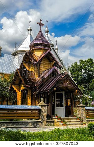 Verkhovyna, Ukraine. Beautiful Wooden Orthodox Church On A Background Of Summer Cloudy Sky