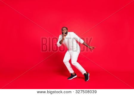 Full Size Photo Of Funny Dark Skin Man Making Newyear Surprise For Girlfriend Going Tiptoe Hold Fing