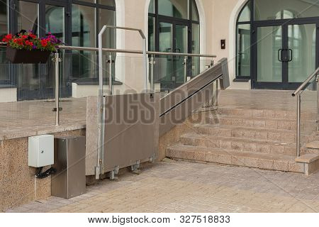 Area Near Entry To Modern Apartment Building With Platform Lift For Disabled Persons Maintenance