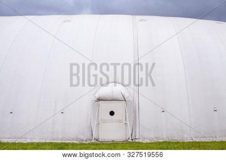 White Inflatable Hangar. Canopy Made Of Tarpaulin. Prefabricated Sports Facilities.
