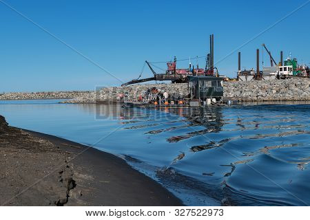 Nome, Alaska - June 9: A Gold Mining Boat Goes Out On The Bering Sea On June 9 2019 In Nome Alaska.