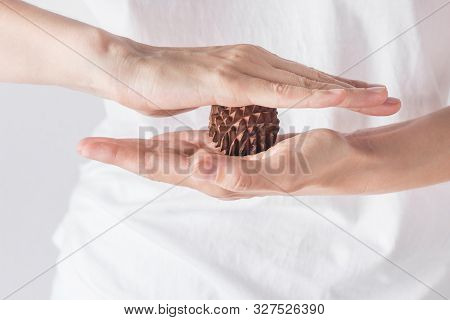 Young Woman Massage Therapist In White Shirt Holds In Hands Spiky Physio Ball From Sandal Wood For R