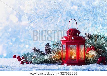 Christmas Lantern In Snow With Fir Tree Branch. Winter Cozy Scene.