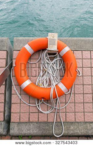 Life Preserver Lifebuoy With Rope At Sea Wall